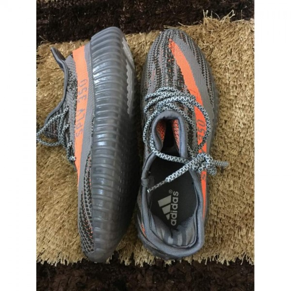 BUY A PAIR OF YEEZY BOOST 350 ORANGE and GREY ANG GET A WATCH FREE