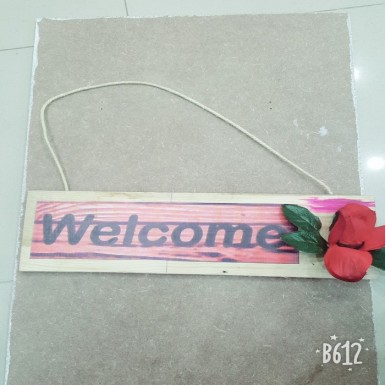 A wooden welcome board
